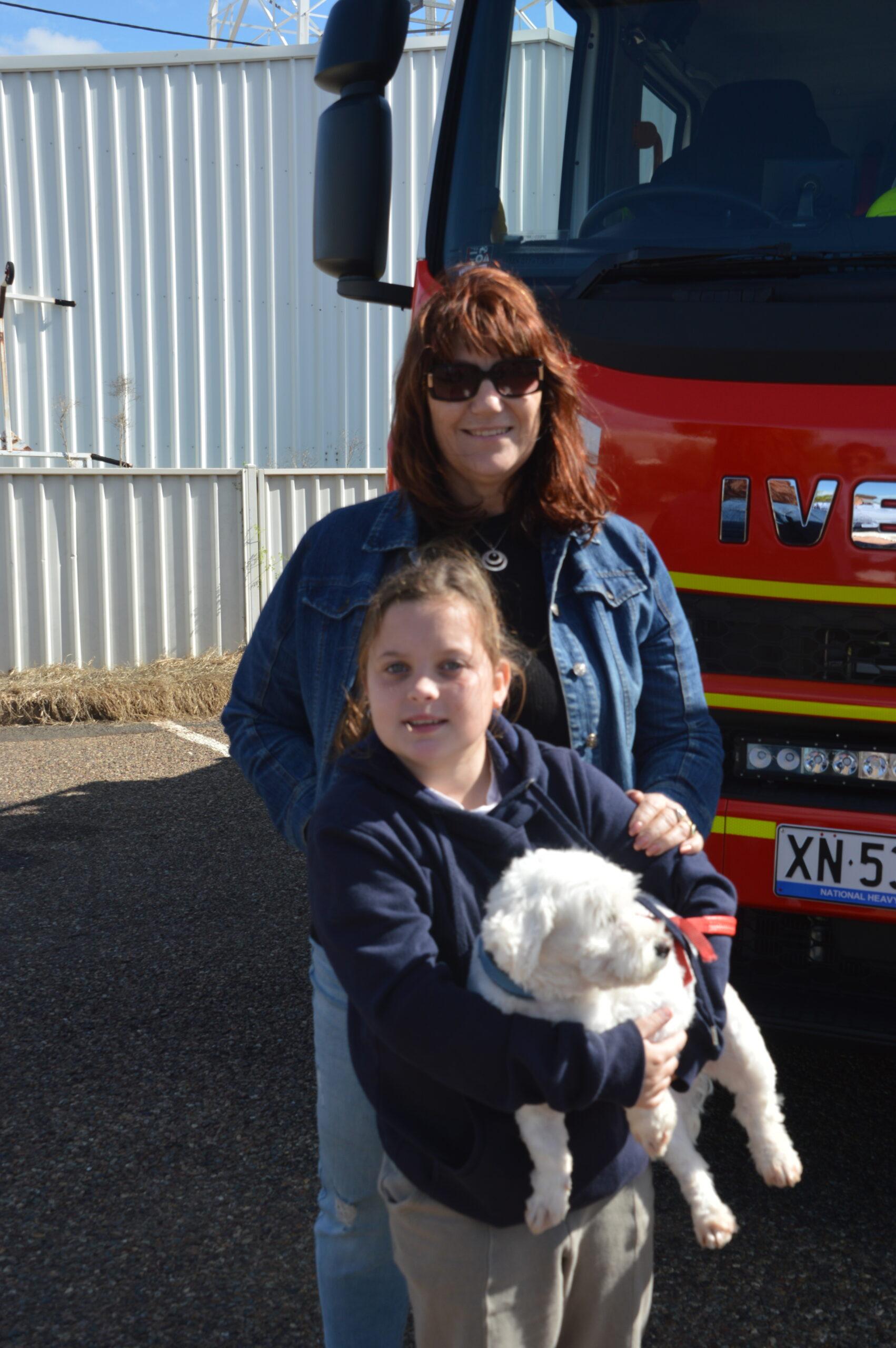 Roz McInnes and Marlei Arnold holding 'Buddy'.