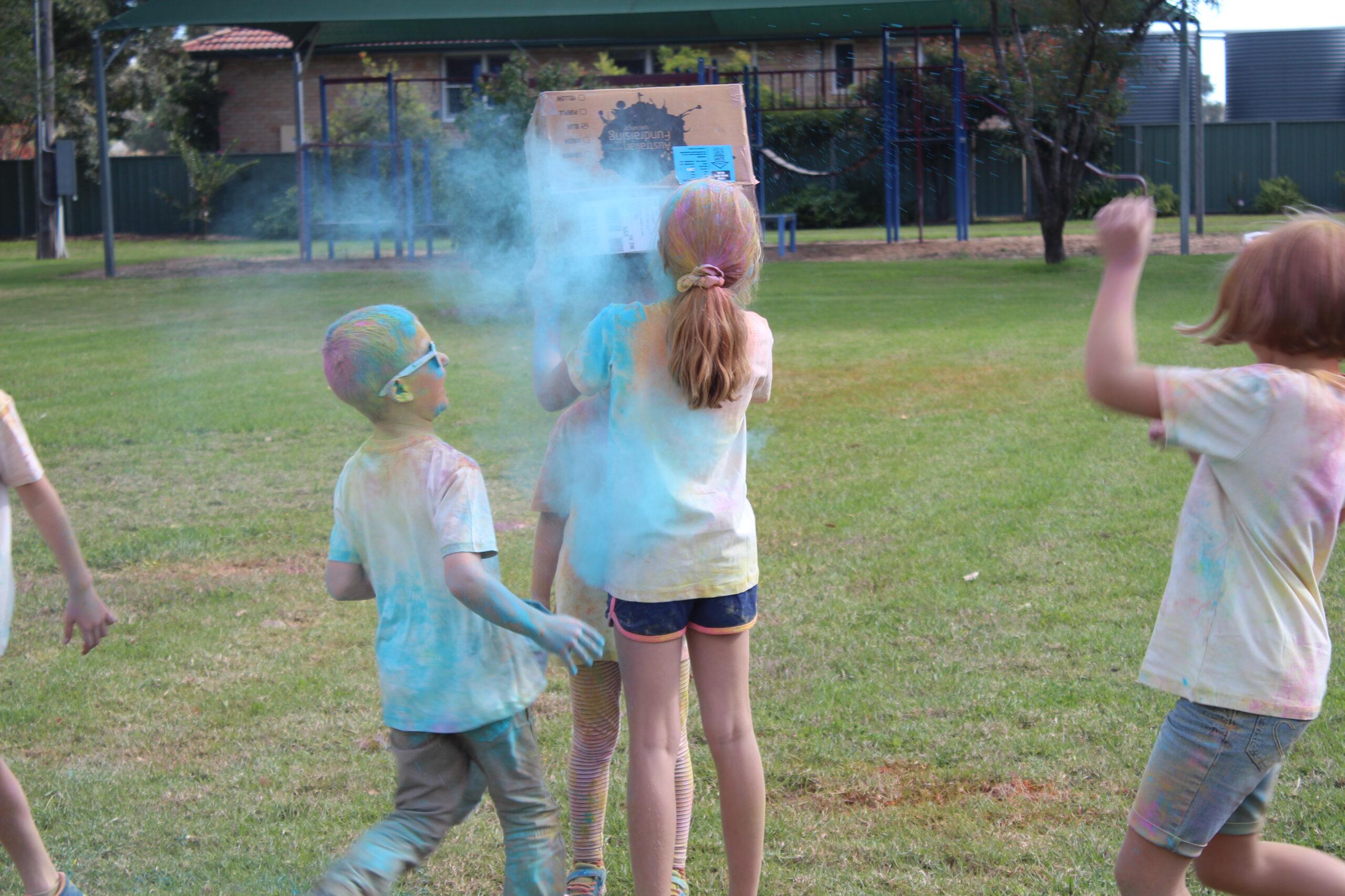 Jackson Smith with Chelsea Nobilo throwing chalk on Ella Smith.