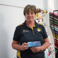 Prize winner: Robina Mowle holding her movie and morning tea voucher, donated by The Crossing Theatre.