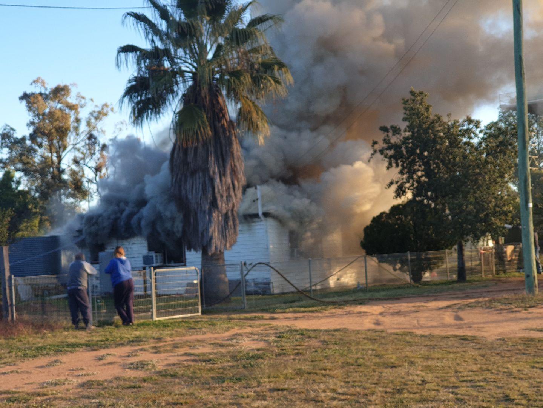 The family home ablaze.