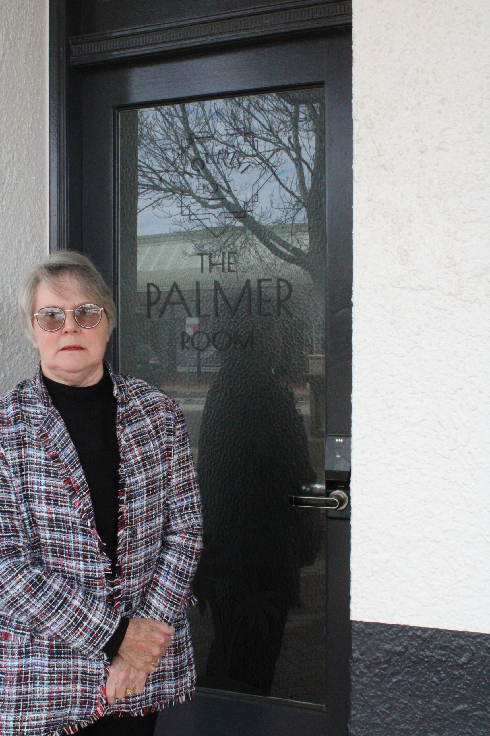 Beth Palmer outside The Palmer Room at the Tourist Hotel, named in honour of Hugh. Hugh's former office has been transformed into a private dining room.