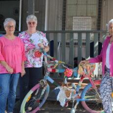 Shop coordinator Ellen Solomon with Narrabri Art & Craft Society president Judy Michell and vice-president Olwyn Campey.